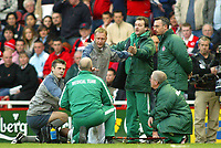 7/11/2004 - FA Barclayship Premiership - Middlesbrough v Bolton Wanderers - The Riverside Stadium<br />The Bolton Wanderers' physios argue and push away the medical staff after they were asked by the referee to bring on the stretcher for Bolton Wanderers' El Hadj Diouf who is lying prostate on the grass<br />Photo:Jed Leicester/Back Page Images