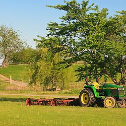A John Deere tractor in a field at the Raymond Farm in Ipswich, Massachusetts.