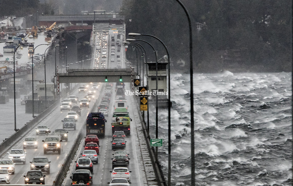 Waves traveling across Lake Washington are buffeted by the Highway 520 floating bridge.<br /> <br /> Steve Ringman / The Seattle Times