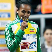 Ethiopia's Genzebe Dibaba celebrates her gold medal holding a national flag after winning the women's 1500m final during the IAAF World Indoor Championships at the Atakoy Athletics Arena, Istanbul, Turkey. Photo by TURKPIX
