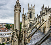 """Rooftop view: York Minster, built over 250 years 1220-1472 AD, is one of the finest medieval buildings in Europe. Also known as St Peter's, its full name is """"Cathedral and Metropolitical Church of St Peter in York,"""" located in England, United Kingdom, Europe. York Minster is the seat of theArchbishop of York, the second-highest office of the Church of England.""""Minster"""" refers to churches established in the Anglo-Saxon period as missionary teaching churches, and now serves as an honorific title.York was founded by the Romans as Eboracum in 71 AD. As the center of the Church in the North, York Minster has played an important role in great national affairs, such as during the Reformation and Civil War. This image was stitched from multiple overlapping photos."""