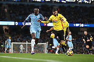 Yaya Toure of Manchester City closes down Miguel Angel Britos of Watford during the English Premier League match at The Etihad Stadium, Manchester. Picture date: December 12th, 2016. Photo credit should read: Lynne Cameron/Sportimage