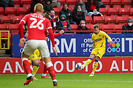 AFC Wimbledon attacker Shane McLoughlin (19) crossing the ball during the EFL Sky Bet League 1 match between Charlton Athletic and AFC Wimbledon at The Valley, London, England on 12 December 2020.