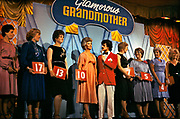 Redcoat running the Glamourous Grandmother competition in Butlins Holiday Camp, Skegness. Butlins Skegness is a holiday camp located in Ingoldmells near Skegness in Lincolnshire. Sir William Butlin conceived of its creation based on his experiences at a Canadian summer camp in his youth and by observation of the actions of other holiday accommodation providers, both in seaside resort lodging houses and in earlier smaller holiday campsThe camp began opened in 1936, when it quickly proved to be a success with a need for expansion. The camp included dining and recreation facilities, such as dance halls and sports fields. Over the past 75 years the camp has seen continuous use and development, in the mid-1980s and again in the late 1990s being subject to substantial investment and redevelopment. In the late 1990s the site was re-branded as a holiday resort, and remains open today as one of three remaining Butlins resorts.