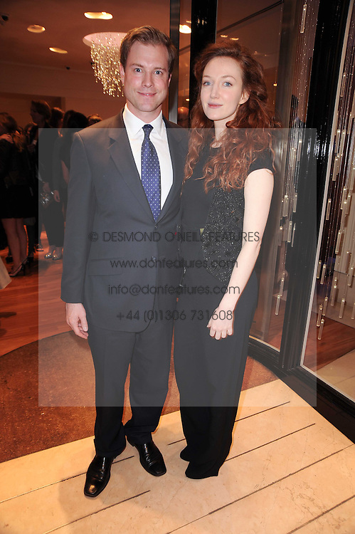 Actress OLIVIA GRANT and RUSSELL BREUER at a party to celebrate the B.zero 1 design by Anish Kapoor held at Bulgari, 168 New Bond Street, London n 2nd June 2010.