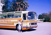 Female tourist boarding sight-seeing tourism bus coach in Tunisia, 1967