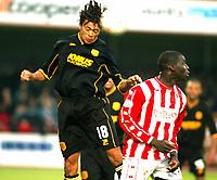 Photo. Chris Ratcliffe<br />Cheltenham v Hull. FA Cup Preliminary Round 08/10/2003<br />jason price beats a static Damian Spencer of Cheltenham