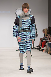 © Licensed to London News Pictures. 30/05/2015. London, UK. A model walks the runway during the Birmingham City University fashion show at Graduate Fashion Week 2015 wearing the collection of graduate student Flo Marriner. Graduate Fashion Week takes place from 30 May to 2 June 2015 at the Old Truman Brewery, Brick Lane. Photo credit : Bettina Strenske/LNP