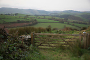 View over a gate towards Machynlleth from Melinbyrhedyn in Wales, United Kingdom.