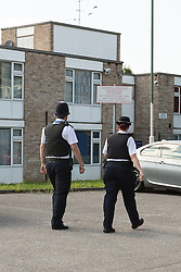 © Licensed to London News Pictures. 06/09/2015. London, UK. Police Officers outside Fernways sheltered housing unit in Fernways off Cecil Road in Ilford, Essex. Police attended the unit last night following reports of an assault. A woman aged in her mid-50's and a man in his mid-80's were pronounced dead at the scene last night, who suffered stabbing injuries. Photo credit : Vickie Flores/LNP