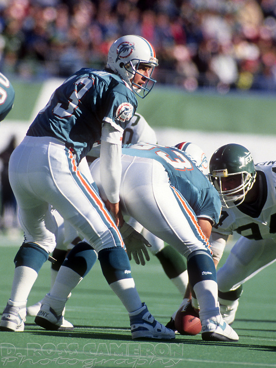 Miami Dolphins quarterback Dan Marino (13) calls the signals during an NFL football game against the New York Jets, Sunday, Nov. 12, 1989 at Giants Stadium in East Rutherford, N.J. The Dolphins won, 31-23. (Photo by D. Ross Cameron)