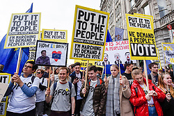 "© Licensed to London News Pictures. 23/03/2019. LONDON, UK.  Protesters at the front of the march.  Thousands of people take part in the ""Put It To The People March"", marching from Park Lane to Parliament Square on what was supposed to be six days before the UK was due to leave the EU, before an extension to the departure date was given.  Protesters demand that the public is given a final say on Brexit as support for the Prime Minister's withdrawal plan continues to recede.  Photo credit: Stephen Chung/LNP"