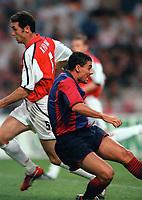 Dani (Barcelona) falls under the challenge of Martin Keown (Arsenal) to win a penalty. Arsenal v Barcelona. The Amsterdam Tournament. Amsterdam Arena, 3/8/2000. Credit: Colorsport / Stuart MacFarlane.