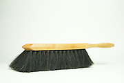still life of a dustpan brush