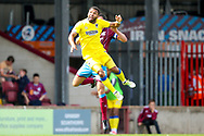 AFC Wimbledon midfielder Andy Barcham (17) climbs high for a header during the EFL Sky Bet League 1 match between Scunthorpe United and AFC Wimbledon at Glanford Park, Scunthorpe, England on 5 August 2017. Photo by Simon Davies.