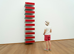 Woman looking at art installation  Untitled 1965 by Donald Judd at Hamburger Bahnhof art museum in Berlin, Germany. .Editorial Use Only.