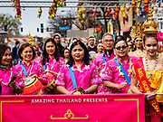"""29 APRIL 2017 - MINNEAPOLIS, MINNESOTA: Thai-Americans wearing traditional Thai holiday shirts perform Thai music during the parade at Songkran Uptown. Several thousand people attended Songkran Uptown on Hennepin Ave in Minneapolis for the city's first celebration of Songkran, the traditional Thai New Year. Events included a Thai parade, a performance of the Ramakien (the Thai version of the Indian Ramayana), a """"Ladyboy"""" (drag queen) show, and Thai street food.     PHOTO BY JACK KURTZ"""