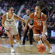 UNCASVILLE, CONNECTICUT- DECEMBER 4: Brooke McCarty #11 of the Texas Longhorns drives past Kia Nurse #11 of the Connecticut Huskies during the UConn Huskies Vs Texas Longhorns, NCAA Women's Basketball game in the Jimmy V Classic on December 4th, 2016 at the Mohegan Sun Arena, Uncasville, Connecticut. (Photo by Tim Clayton/Corbis via Getty Images)