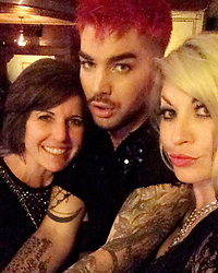 """Adam Lambert releases a photo on Instagram with the following caption: """"Little throwback from last weeks Hollywood Bowl shows: my gorgeous mom and the beautiful @daniellestori"""". Photo Credit: Instagram *** No USA Distribution *** For Editorial Use Only *** Not to be Published in Books or Photo Books ***  Please note: Fees charged by the agency are for the agency's services only, and do not, nor are they intended to, convey to the user any ownership of Copyright or License in the material. The agency does not claim any ownership including but not limited to Copyright or License in the attached material. By publishing this material you expressly agree to indemnify and to hold the agency and its directors, shareholders and employees harmless from any loss, claims, damages, demands, expenses (including legal fees), or any causes of action or allegation against the agency arising out of or connected in any way with publication of the material."""