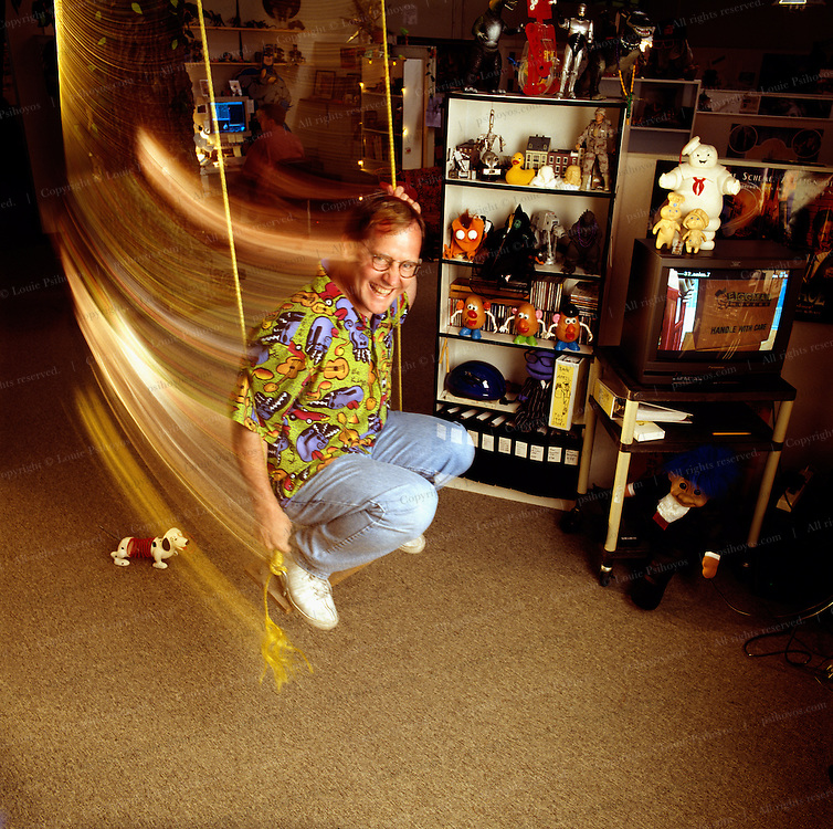 John Lasseter on the eve of his first hit Toy Story at Pixar headquarters in California.  The Pixar offices are very playful and feature swings and scooters to keep the atmosphere cheerful.<br /> Pixarians lounge with CEO Jobs on couch front right and John Lasseter lying down on couch, in screening room before the launch of movie Toy Story.  All the animators in the picture became multi-millionaires their stock options.<br /> Steve Jobs, founder of Apple Computer bought animation company Pixar off George Lukas in 1986 and turned it into a Academy-Award-winning studio.  The oversized lamp is an icon of Pixar's first animation success.