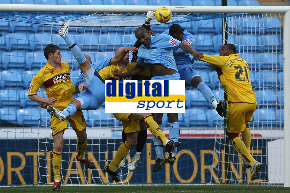 Photo: Pete Lorence.<br />Coventry City v Burnley. Coca Cola Championship. 09/12/2006.<br />Andy Marshall punches the ball clear during a goalmouth scuffle.