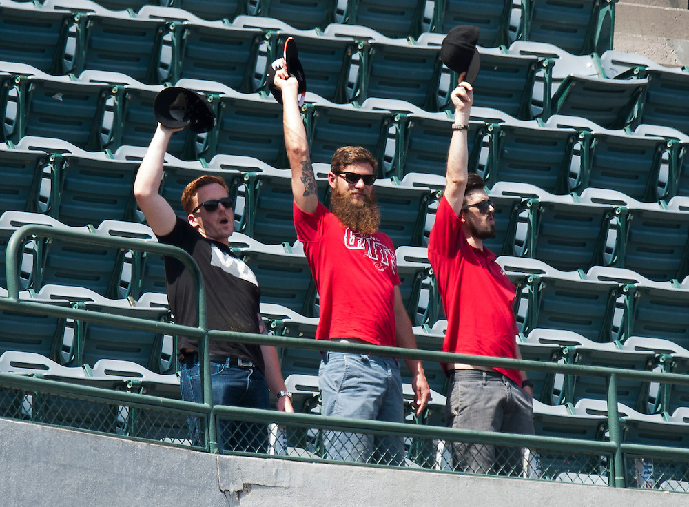 """Angel fans cheer from the cheap seats during """"Take Me Out to the Ball Game"""" during the Angels' preseason game against the Chicago Cubs at Angel Stadium Sunday.<br /> <br /> <br /> ///ADDITIONAL INFO:   <br /> <br /> angels.0404.kjs  ---  Photo by KEVIN SULLIVAN / Orange County Register  --  4/3/16<br /> <br /> The Los Angeles Angels take on the Chicago Cubs at Angel Stadium during a preseason game at Angel Stadium Sunday.<br /> <br /> <br />  4/3/16"""