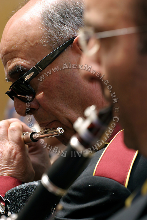 Members of the band playing during the snake Procession of Cocullo, one of the oldest pagan Christian celebrations still held today in Italy, on Thursday, May 5, 2005. Saint Domenico, the peculiar Saint of the event, was thought to protect from and heal snake bites. **ITALY OUT**