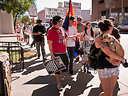 16 OCTOBER 2011 - PHOENIX, AZ: Occupy Phoenix protesters march through downtown Sunday afternoon. About 200 people continued the Occupy Phoenix protest in downtown Phoenix Sunday afternoon. The protest peaked Saturday afternoon at about 2,000 people. Nearly 50 people were arrested late Saturday night on misdemeanor trespassing charges when they tried to camp in a park near downtown and on Sunday the crowd dwindled to 200. Protesters hope to continue the protest through Monday by marching around downtown and picketing banks in the area.   PHOTO BY JACK KURTZ