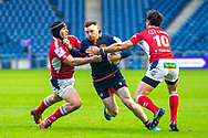 George Taylor (#12) of Edinburgh Rugby is tackled by Clement Martinez (#2) and Raphael Lagarde (#10) of SU Agen Rugby during the European Rugby Challenge Cup match between Edinburgh Rugby and SU Agen at BT Murrayfield, Edinburgh, Scotland on 18 January 2020.