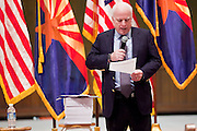 Nov. 23, 2009 -- PHOENIX, AZ: Sen. JOHN McCAIN (R-AZ) reads what he said was HR 3962, the House of Representatives' health care reform bill, during a town hall meeting on health care reform at North Phoenix Baptist Church in Phoenix, AZ. About 300 people, most of them medical professionals, attended the meeting to hear Sen. McCain talk about the health care reform proposals currently in congress and to give McCain their opinions on health care reform.   Photo by Jack Kurtz