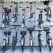 An organized bike rack making efficient use of space in Switzerland.