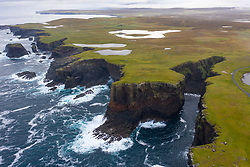 Dramatic cliffs with Calder's Geo to right, on coast at Eshaness at Northmavine , north mainland of Shetland Islands, Scotland, UK