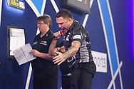 Gerwyn Price celebrates winning a set during the William Hill World Darts Championship Semi-Finals at Alexandra Palace, London, United Kingdom on 2 January 2021.