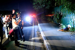 November 14, 2016 - Philippines - (EDITOR'S NOTE: Image depicts death) Members of the media documents, the crime scene and the remain of two un-identified summary execution victims at Diokno Blvd. Brgy 76, Zone 10, Pasay City. It'Äôs a part of the total out war campaign by the government about illegal drugs. (Credit Image: © Gregorio B. Dantes Jr/Pacific Press via ZUMA Wire)