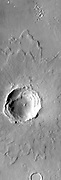 Today's VIS image contains a relatively young crater and its ejecta. Layering in the ejecta is visible and relates to the shock waves from the impact. This unnamed crater is located in Arabia Terra.