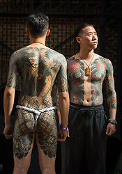 Tattoo artist Sakyo (right) and Wang Ching-Tun, both of Diao Zuo tattoo during the International tattoo convention at Tobacco Dock in east London.