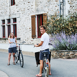 A locally-settled Dutch/US couple with their bikes. Saint-Pierre-de-Frugie, France. July 12, 2019.