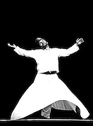 Whirling Dervish dancer on black and white
