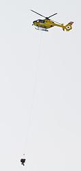 20.01.2011, Hahnenkamm, Kitzbuehel, AUT, FIS World Cup Ski Alpin, Men, Training, im Bild // den Abtransport von Hans Grugger (AUT) mit einem ÖAMTC Hubschrauber nach seinem schweren Sturz auf der Streif // during the men´s downhill training run at the FIS Alpine skiing World cup in Kitzbuehel, EXPA Pictures © 2011, PhotoCredit: EXPA/ S. Zangrando