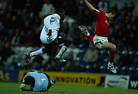 Fotball<br /> FA Cup England 2004/2005<br /> 3. runde<br /> 08.01.2005<br /> Foto: SBI/Digitalsport<br /> NORWAY ONLY<br /> <br /> Preston NE v West Bromwich Albion<br /> <br /> Patrick Agyemang of Preston and Neil Clement of WBA hurdle over the advancing WBA goalkeeper Russell Hoult