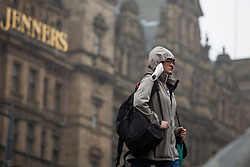 © Licensed to London News Pictures.  09/09/2021. Edinburgh, Scotland. A woman walks in the rain at Princes Street in Edinburgh. Scotland is currently the Covid capital of the UK with 17 out of 20 hotspots north of the border. Photo credit: Marcin Nowak/LNP