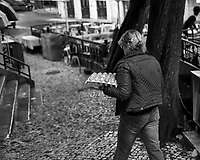 Egg Delivery Person. Morning Street Photography in Sintra. Image taken with a Fuji X-T3 camera and 35 mm f/1.4 lens.
