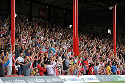 A general view of Brentford supporters celebrating a goal - Photo mandatory by-line: Patrick Khachfe/JMP - Mobile: 07966 386802 09/08/2014 - SPORT - FOOTBALL - Brentford - Griffin Park - Brentford v Charlton Athletic - Sky Bet Championship - First game of the season