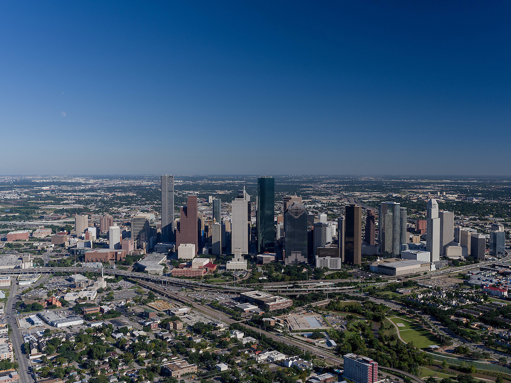 Aerial view of Houston, Texas with skyline during daytime and I-45 freeway in foreground.