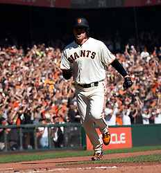 Oct 3, 2021; San Francisco, California, USA; San Francisco Giants starting pitcher Logan Webb (62) reacts as he scores from third on a single by Buster Posey against the San Diego Padres during the third inning at Oracle Park. Mandatory Credit: D. Ross Cameron-USA TODAY Sports