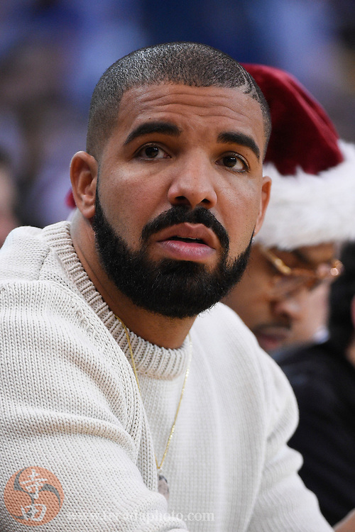 December 25, 2015; Oakland, CA, USA; Recording artist Drake sits courtside in the second quarter of a NBA basketball game on Christmas between the Golden State Warriors and the Cleveland Cavaliers at Oracle Arena.