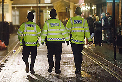© licensed to London News Pictures. London, UK 01/01/2014. Police officers patrolling whilst revellers in Soho, London celebrating the New Year at the first hours of 2014. Photo credit: Tolga Akmen/LNP