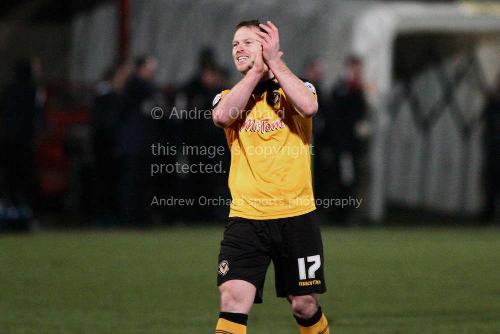 Michael Flynn of Newport County applauds the travelling fans at the end of the match.<br /> Skybet football league two match, Cheltenham Town  v Newport County at The Abbey Business Stadium, Whaddon Road in Cheltenham, Glos on Sunday 28th December 2014.<br /> pic by Mark Hawkins, Andrew Orchard sports photography.