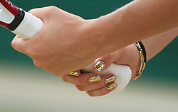 27.06.2011, Wimbledon, London, GBR, WTA Tour, Wimbledon Tennis Championships, im Bild Caroline Wozniacki (DEN) with gold union jack finger nails in action during the Ladies' Singles 4th Round match on day seven of the Wimbledon Lawn Tennis Championships at the All England Lawn Tennis and Croquet Club. EXPA Pictures © 2011, PhotoCredit: EXPA/ Propaganda/ David Rawcliffe +++++ ATTENTION - OUT OF ENGLAND/UK +++++ // SPORTIDA PHOTO AGENCY