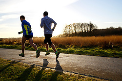 © Licensed to London News Pictures. 13/01/2016. London, UK. People running in Richmond Park in London at sunrise following one of the coldest nights in a year as temperatures in the capital drop as low as -1C on Wednesday, 13 January 2016. Photo credit: Tolga Akmen/LNP